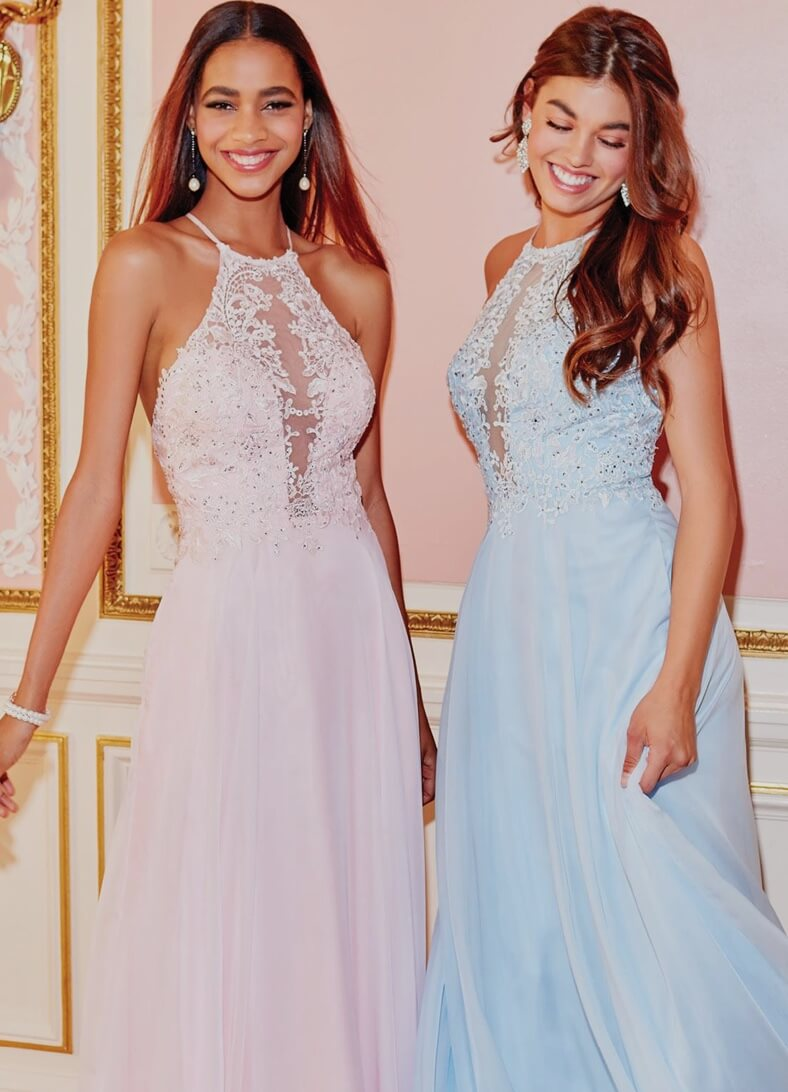 Bridesmaids wearing blue and pink dresses